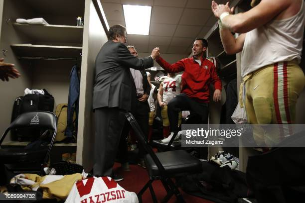 CoChairman John York and Head Coach Kyle Shanahan of the San Francisco 49ers highfive in the locker room following the game against the Los Angeles...