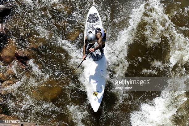 Charlie MaCarthur, Snowmass Village Colorado, negotiates the Gore River during the SUP Surf Sprint at the 10th annual Teva Mountain Games in Vail...