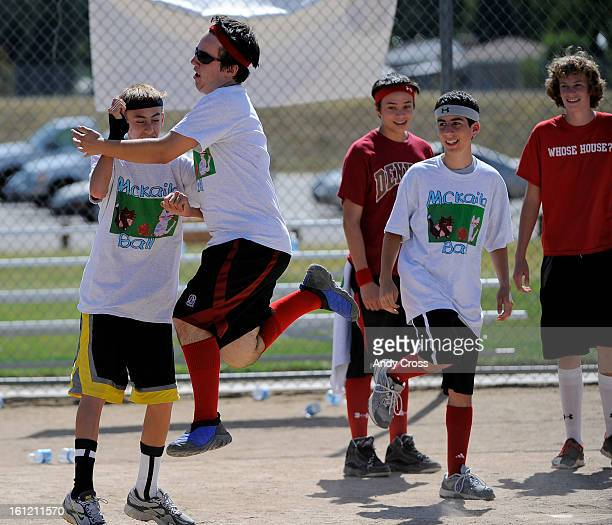 DENVER COChris Moreno left celebrates coming to home plate with teammate with Josh Murdy left during the 3rd annual McKaila Ball a kickball party at...