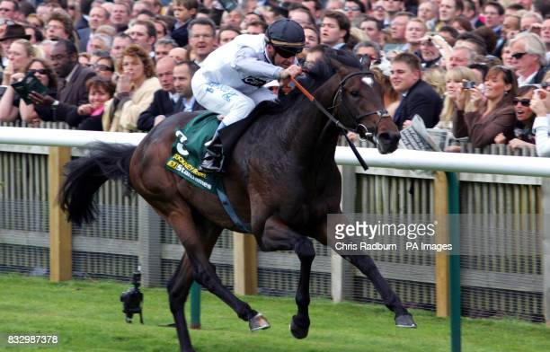 Cockney Rebel and Jockey Olivier Peslier win The Stan james 2000 Guineas Stakes at Newmarket Racecourse