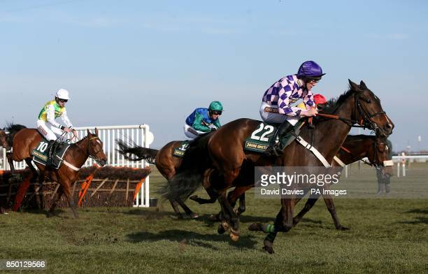 Cockney Sparrow ridden by jockey Dean Pratt in action during the John Smith's Handicap Hurdle during Grand National Day at Aintree Racecourse...