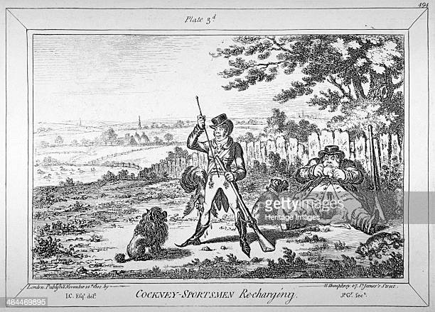 'Cockneysportsmen recharging' 1800 A young cit standing legs astride negligently using a ramrod His companion is leaning against a fence gnawing...