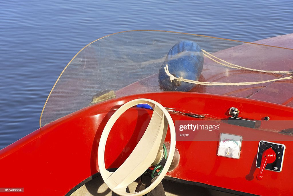 Cockpit and steering wheel of a motorboat at the lake : Stock Photo