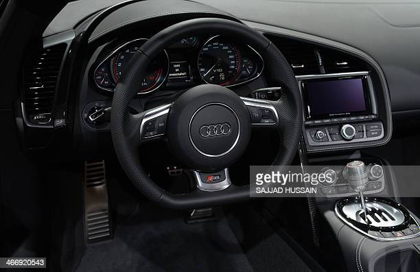 Cockpit detail of an Audi R8 V10 sports car is pictured at the 12th Auto Expo in Greater Noida on the outskirts of New Delhi on February 5 2014 AFP...