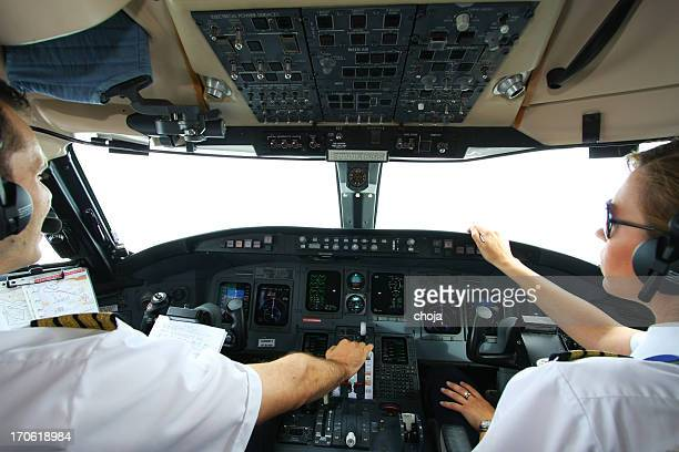 Cockpit of an airplane with young pilots flying
