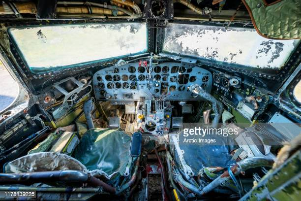 cockpit of an old broken down rusting airplane. - airplane crash stock pictures, royalty-free photos & images