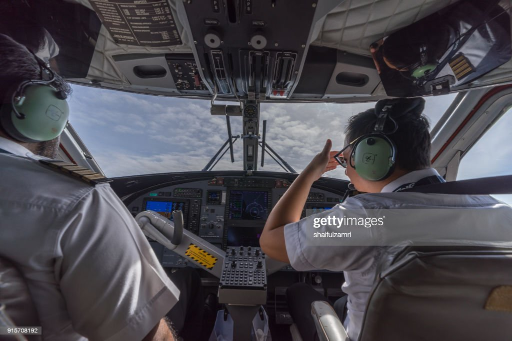 Cockpit view of MASwings 19-seater Twin Otter aircraft in flight from Miri Airport to Bario Airport : Stock Photo