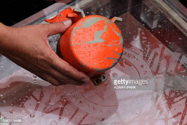 A cockpit voice recorder the second black box from Lion Air flight 610 that crashed last October killing all 189 people onboard is displayed to the...