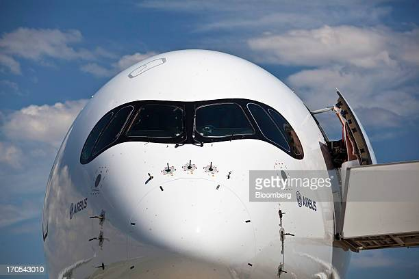 Cockpit windows sit above the nose of an Airbus SAS A350 produced by a unit of European Aeronautic Defence Space Co following its first flight in...