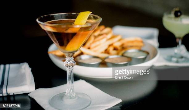A cocktail and French Fries