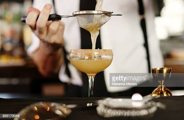 a cocktail being served at a bar - cocktail stock pictures, royalty-free photos & images
