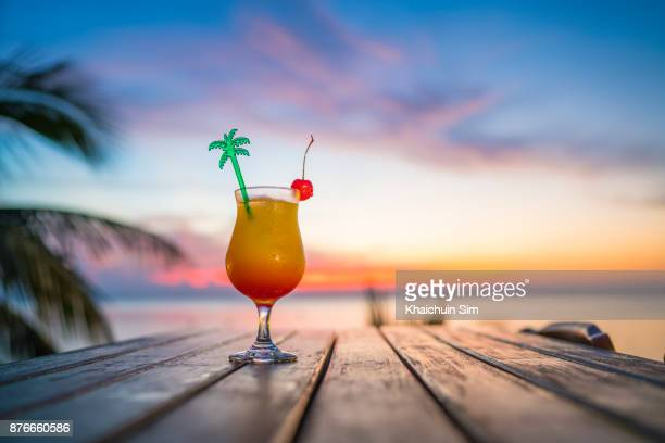 cocktail during sunset at beach - cocktail stock pictures, royalty-free photos & images