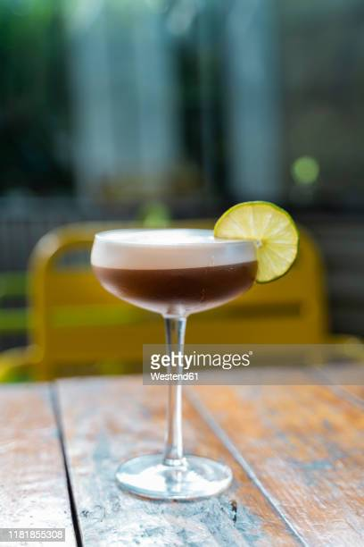cocktail glass with slice of lemon - garnish stock pictures, royalty-free photos & images
