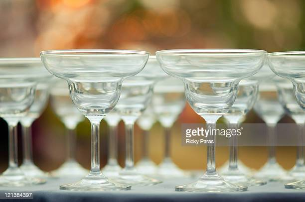 cocktail glasses on table - martini glass stock photos and pictures