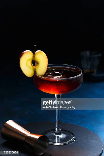 cocktail in coupe glass with apple garnish - whisky stock pictures, royalty-free photos & images