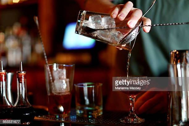 cocktail making - cocktail stock pictures, royalty-free photos & images