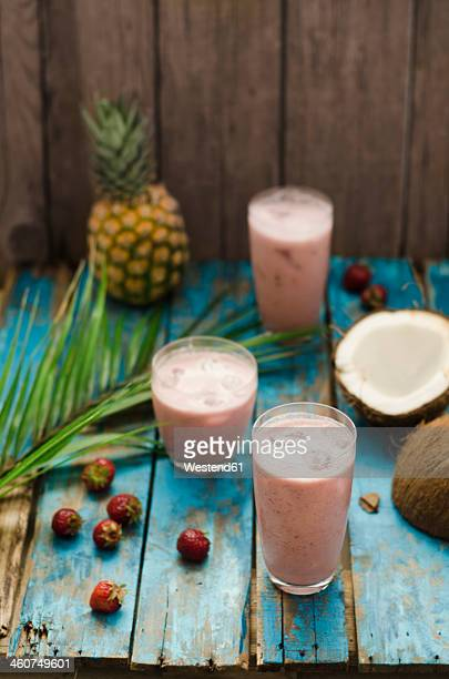 Cocktail of fresh fruits on wooden table, close up