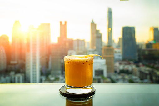 Cocktail om Bangkok city view point from rooftop of building, blue sky and city light, Bangkok is the most populated city in Southeast Asia. Bangkok , Thailand - gettyimageskorea