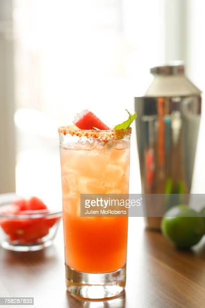 cocktail on the table near cocktail shaker - margarita drink stock photos and pictures