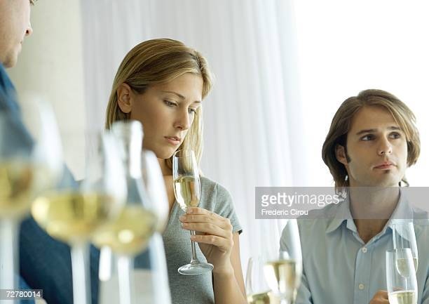Cocktail party, focus on woman looking down