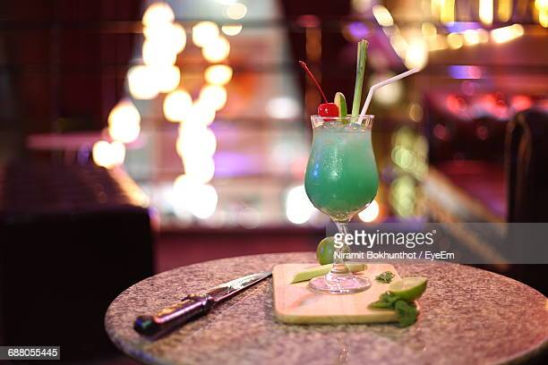 Cocktail Served On Table In Illuminated Restaurant