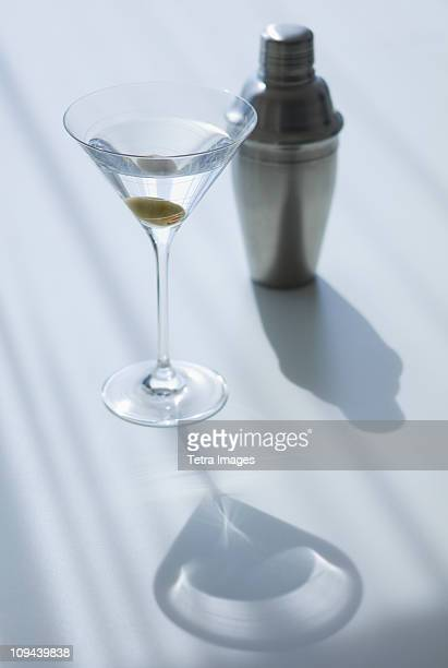 Cocktail shaker and cocktail in glass