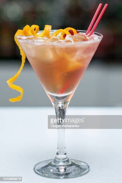 cocktail with orange peel in a glass - garnish stock pictures, royalty-free photos & images