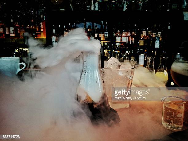 Cocktail With Smoke On Bar Counter