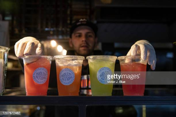 Cocktails are for sale to go at Dudley's bar and restaurant in Manhattan as the Coronavirus, COVID19, outbreak continued unabated on March 19, 2020...