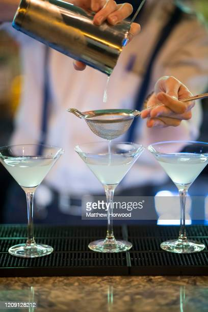 Cocktails are poured into cocktail glasses in a UK bar on October 28, 2016 in Cardiff, United Kingdom. A new law setting a minimum alcohol price came...