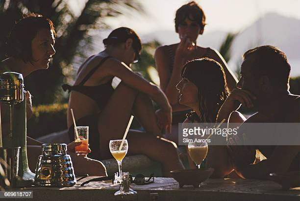 Cocktails in Teddy Stauffer's swimming pool in Acapulco Mexico February 1966