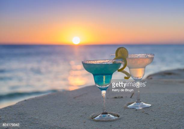 Cocktails on an island beach at sunset