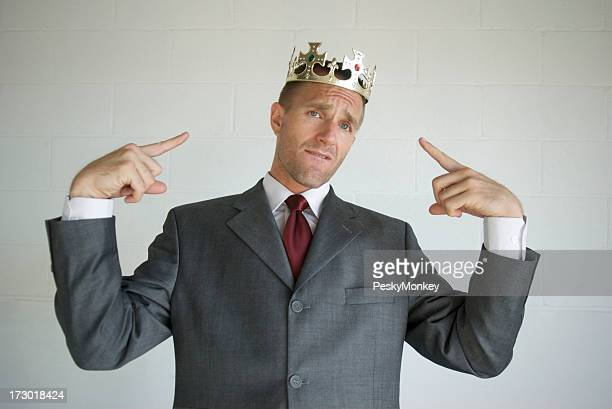 Cocky Businessman Pointing to Golden Crown Like He's the King