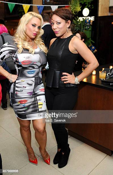 Coco and Selenis Leyva celebrate the launch of Sunset Overdrive at the XboxOne Loft on October 27 2014 in New York City