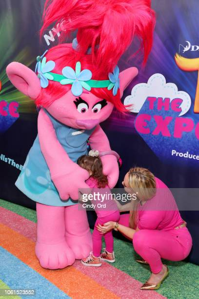 Coco Austin and daughter Chanel Marrow attend DreamWorks Trolls The Experience Rainbow Carpet Grand Opening on November 14 2018 in New York City