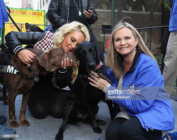 Coco Austin and Dr Robin Ganzert attend America Salutes FourLegged Military Heroes During 2014 Veterans Day Parade on November 11 2014 in New York...