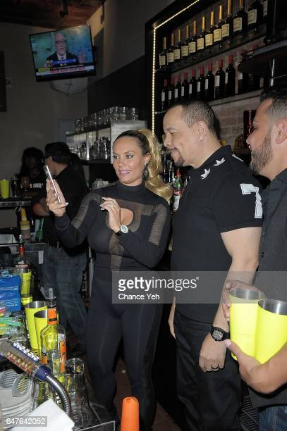 Coco Austin and IceT bartend at TGI Fridays Endless Happy Hour with IceT at TGI Fridays on March 3 2017 in New York City