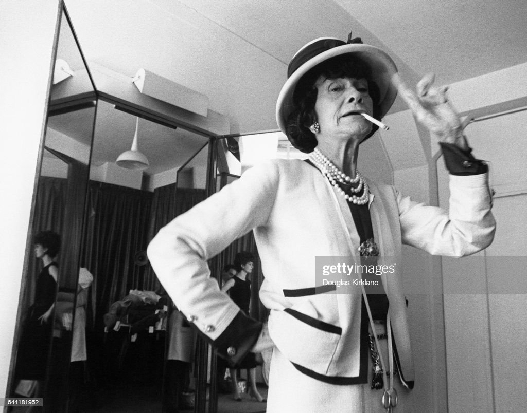 Coco Chanel smoking cigarette in dressing room.