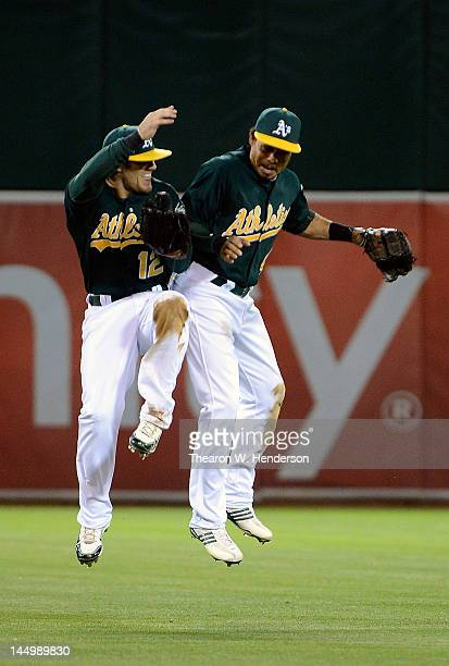 Coco Crisp and Collin Cowgill of the Oakland Athletics celebrate defeating the Los Angeles Angels of Anaheim 2 to 1 at Oco Coliseum on May 21 2012 in...