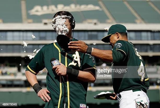 Coco Crisp covers Josh Reddick of the Oakland Athletics with a cream pie after Reddick had the gamewinning hit in the ninth inning of their game...