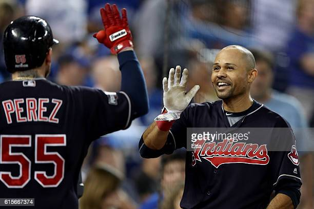 Coco Crisp of the Cleveland Indians celebrates with Roberto Perez after hitting a solo home run in the fourth inning against Marco Estrada of the...