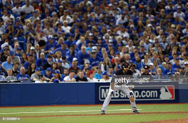 Coco Crisp of the Cleveland Indians takes a lead off third base in the top of the ninth inning of ALCS Game 3 against the Toronto Blue Jays at the...