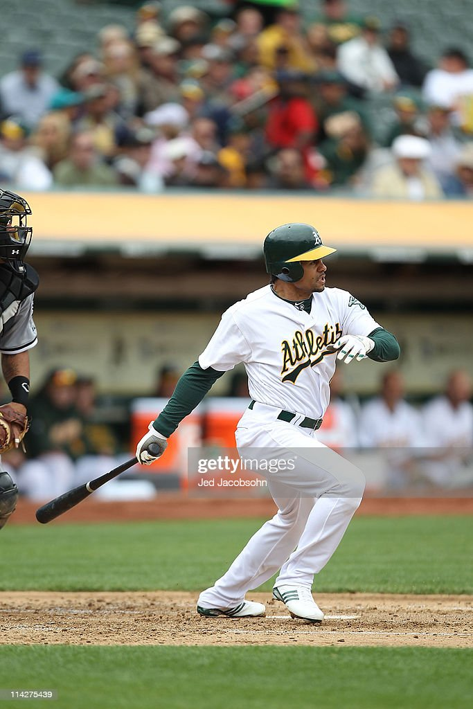 Coco Crisp #4 of the Oakland Athletics bats against the Chicago White Sox during a Major League Baseball game at the Oakland-Alameda County Coliseum on May 14, 2011 in Oakland, California.