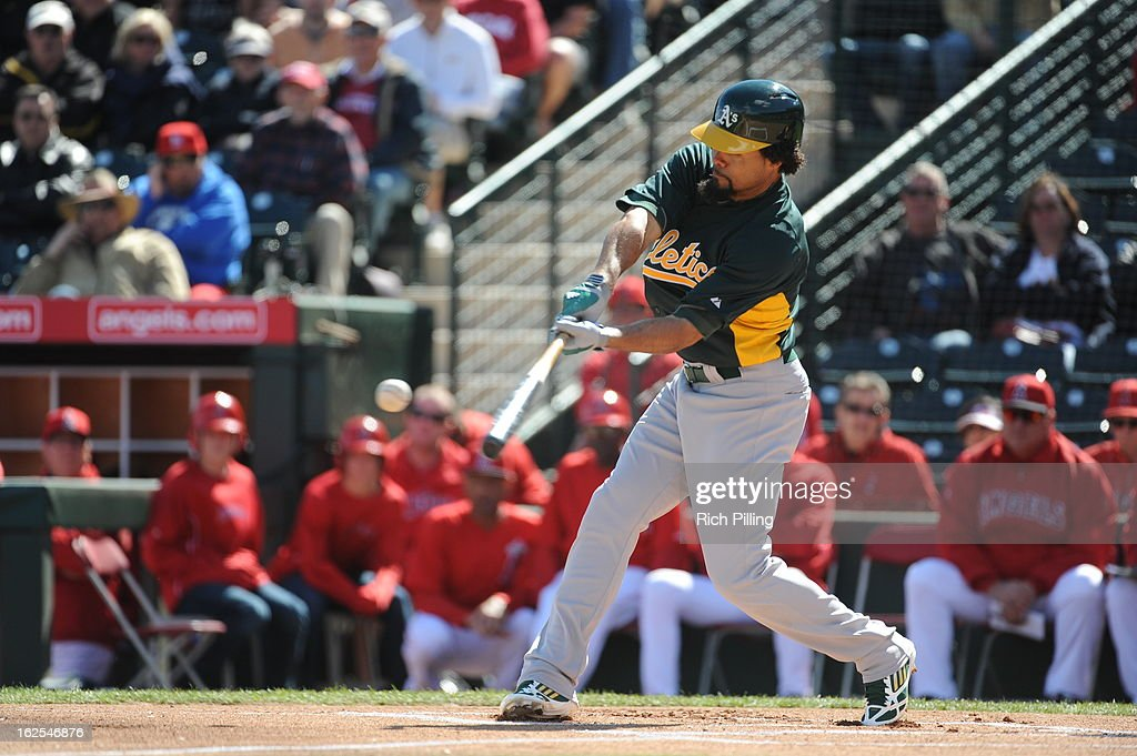 Coco Crisp #4 of the Oakland Athletics bats during the game against the Los Angeles Angeles of Anaheim on February 24, 2013 at Tempe Diablo Stadium in Tempe, Arizona. The Athletics defeated the Angels 7-5.