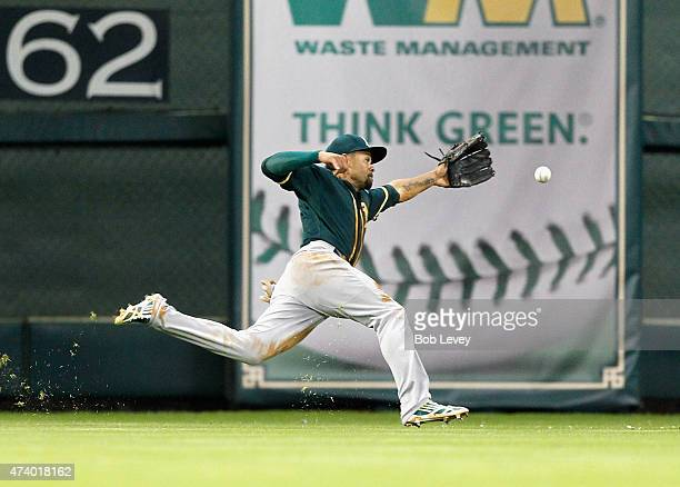 Coco Crisp of the Oakland Athletics can't track down this line drive off the bat of Colby Rasmus of the Houston Astros in the second inning at Minute...