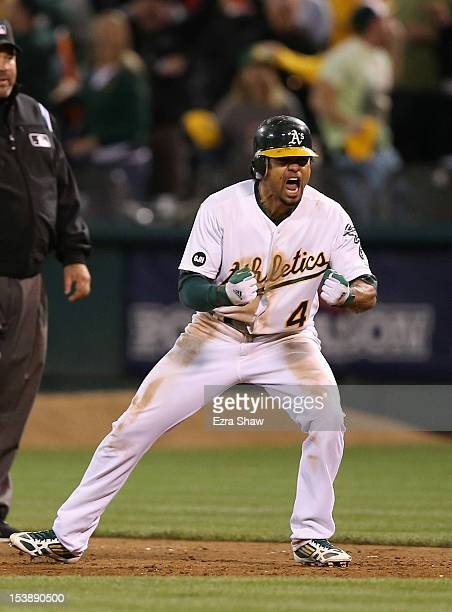 Coco Crisp of the Oakland Athletics celebrates after he hit a game-winning single to beat the Detroit Tigers in the ninth inning of Game Four of the...