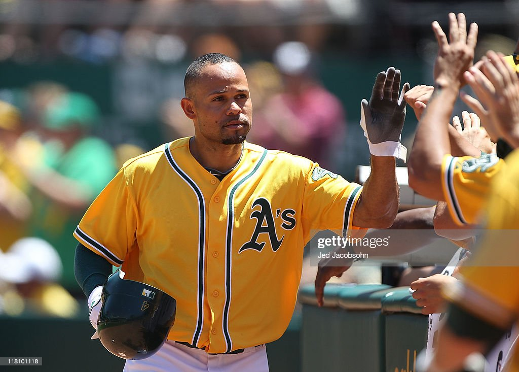 Coco Crisp #4 of the Oakland Athletics celebrates in the fourth inning after scoring on a David DeJesus double against the Arizona Diamondbacks at Oakland-Alameda County Coliseum on July 3, 2011 in Oakland, California.