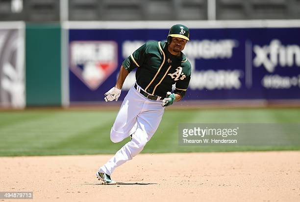 Coco Crisp of the Oakland Athletics races into third base safe against the Detroit Tigers in the bottom of the fifth inning at Oco Coliseum on May 29...