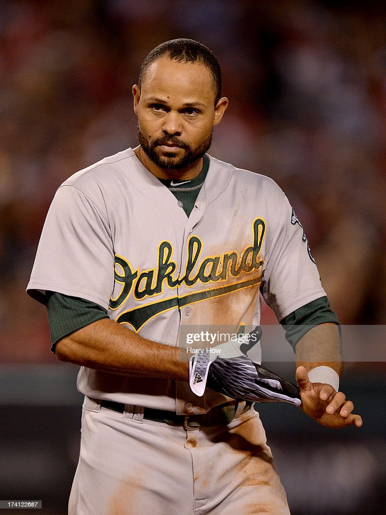 Coco Crisp #4 of the Oakland Athletics reacts after teammate John Jaso #5 was thrown out at first base to end the fifth inning against the Los Angeles Angels at Angel Stadium of Anaheim on July 19, 2013 in Anaheim, California.