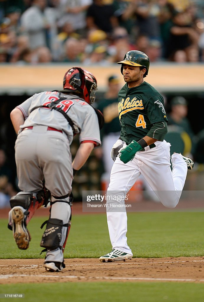 Coco Crisp #4 of the Oakland Athletics scores on an RBI single from Yoenis Cespedes #52 in the third inning against the Cincinnati Reds at O.co Coliseum on June 25, 2013 in Oakland, California.